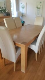 Solid oak and marble dining table and six chairs