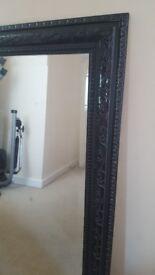Antique style black ornate mirror