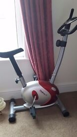 Exercise bike with adjustable tension/difficulty, heart rate monitor and calorie counter
