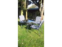 Garden table & 3 chairs with cushions £25