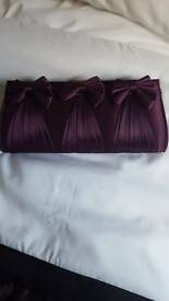 Plum clutch bag