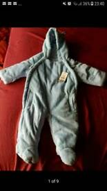 Brand new fluffy baby winter suit from 3-6 months + a free musical activity toy