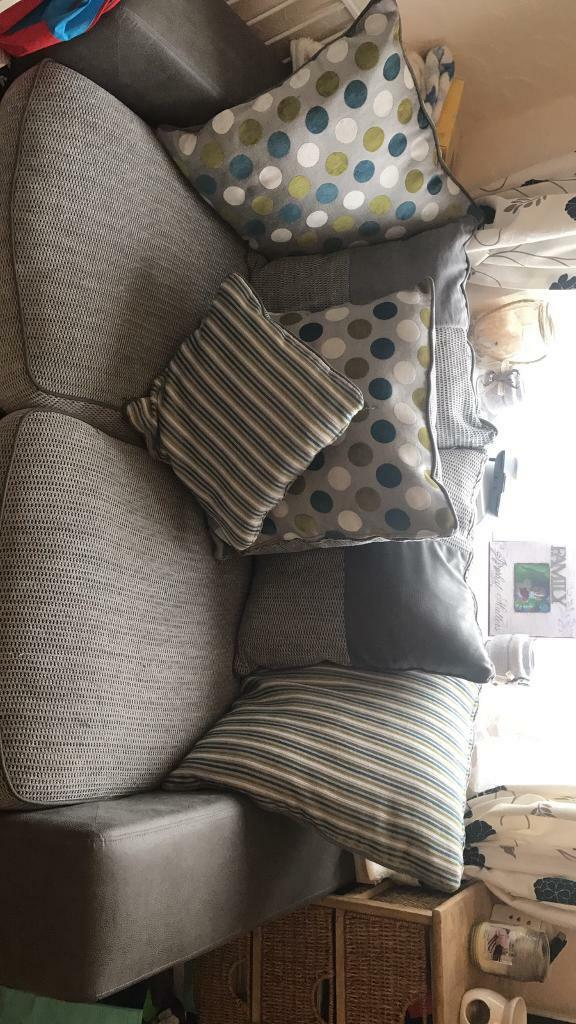 Two Seater Sofain Westbury, WiltshireGumtree - Beautiful grey two Seater Sofa. Barely ever used. All scatter cushions are included. There are a few pulls on the cushions but nothing major
