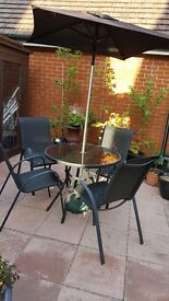 4 chairs & table with umberella