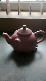 1 lime green teapot and 1 pink elephant teapot both ceramic