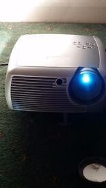 Great projector with speakers and protective case.