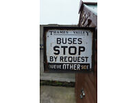 bus stop sign old double sided