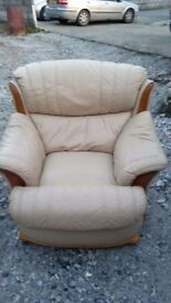 2 Cream leathersofa chairs 1 of them is a reclainer chair in good condition