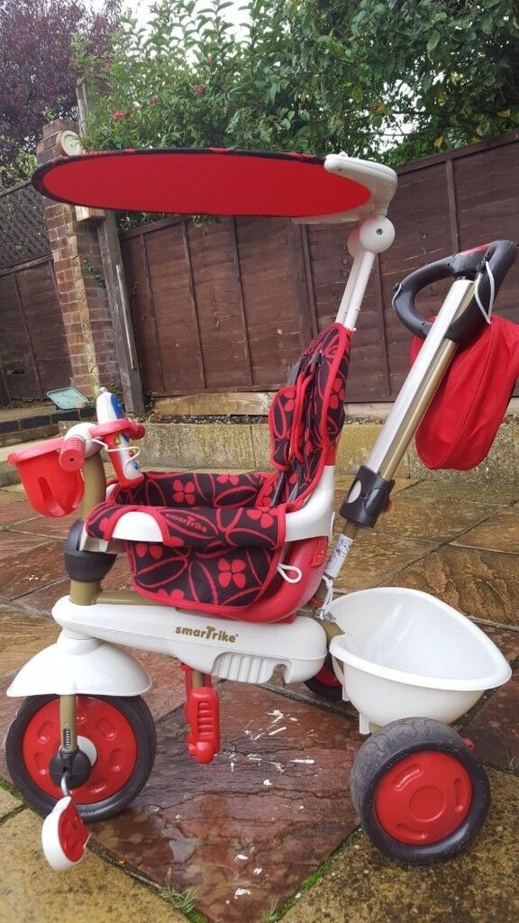 Red 4-in-1 SmarTrike with touch steering