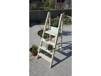 Vintage wooden step ladder for displaying plants, looks lovely with lights in the evening