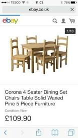 Brand new and still boxed Corona dining table and chairs RRP £110