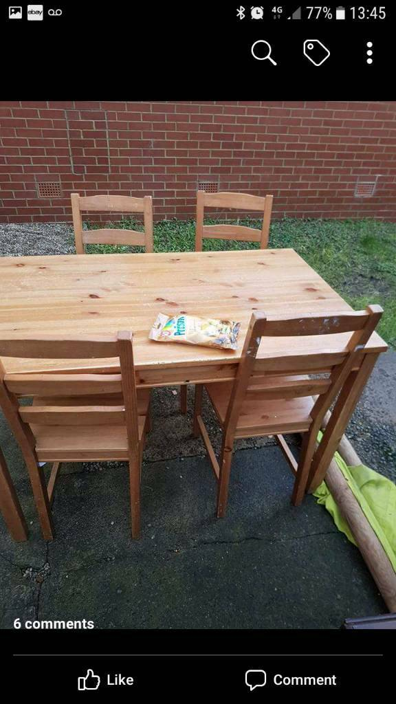 Table and 4 chairs in a used condition