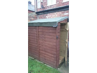 Small Shed with pitched roof and steel security bar