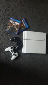 Playstation4 in white , 2 games , 2 pads excellent condition as rarely used