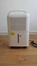 Stylish Dehumidifier used only once & in new condition original cost £110. Offer price £40