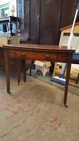 Foldaway extending dining table with drawer