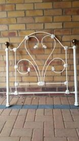 Ornate metal frame single bed with mattress