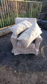 Fixed easy chair with cushions