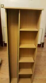 CD storage unit with shelves.