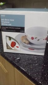 Reduce price. Tesco beautiful art deco rose 12 piece dinner set. Brand new never been used.