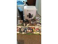 xbox 360 console and 10 games plus x2 headphones and controller