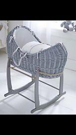 Grey wicker Moses basket