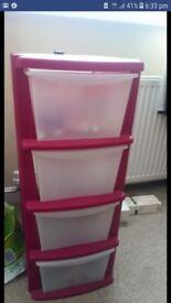Pink plastic box storage unit