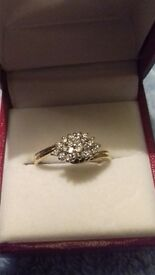 9ct gold diamond cluster ring, valued at £950