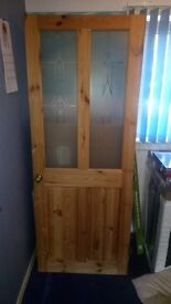 Two interior doors four panel two glass two wood.