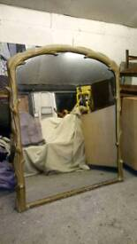 A large Victorian over mantle mirror