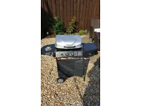 Gas BBQ with side hot plate