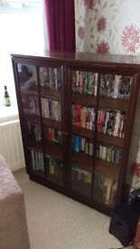 Glass fronted display cupboard with light