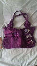 Lovely purple textile bag with flowers