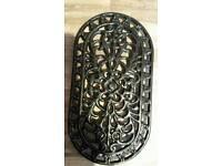 Black cast iron trivet