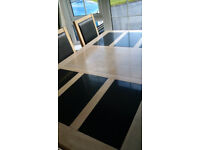 Dining table with granite insets.