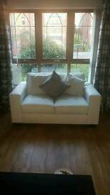 Cream leather 3 + 2 seater sofas