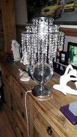 heavy table lamp with chrome base and glass droplet shade