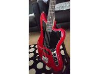 Squier Vintage Modified Jaguar Bass Special in Crimson Red Transparent