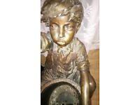 Bronze garden fountain depicting boy sitting by barrel. Very heavy.