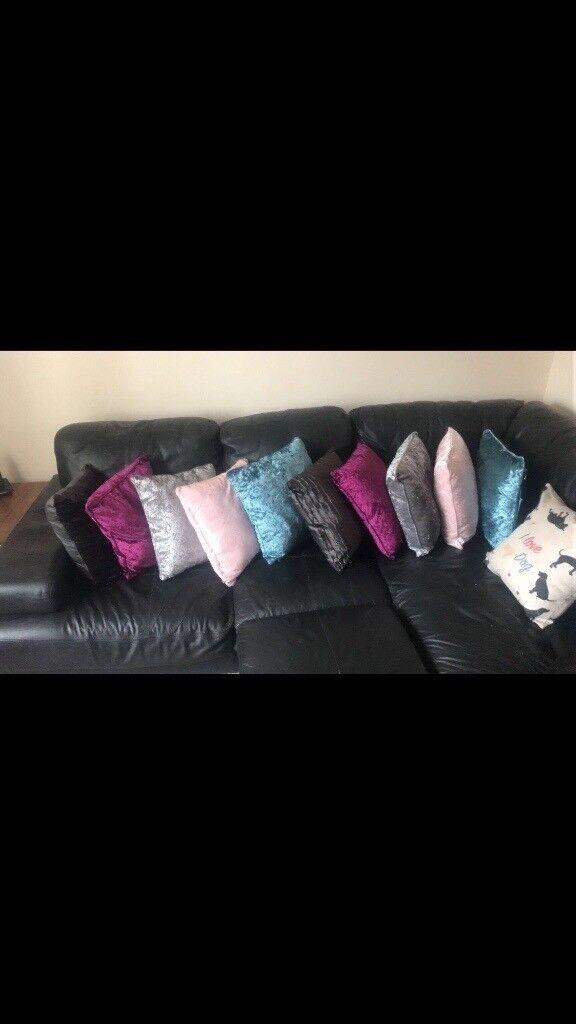 Large black left handed corner sofa with large foot rest