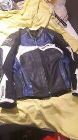 2 peace RST pro racing motorcycle leathers in blue black and silver
