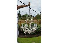 Large metal light fitting with clear and pink crystals. Has 8 candle bulbs