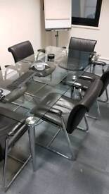 Glass meeting/dinner table and 8 leather Chairs