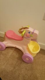 Fisher price ride along muscial pony