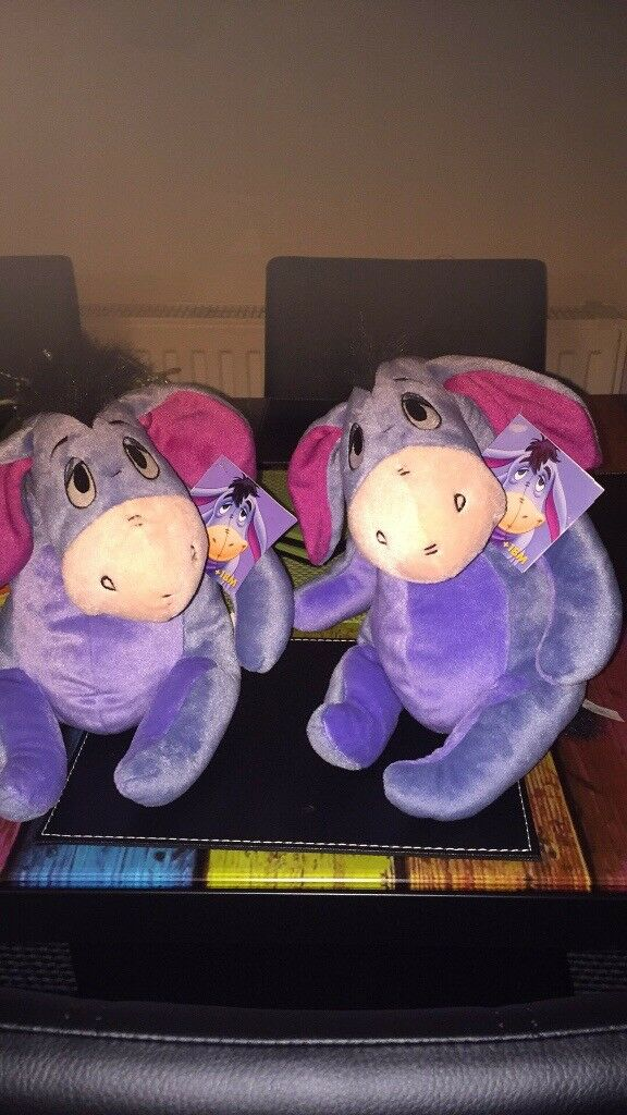 Brand new fisher price Disney Eeyore 2 of still tagged 5.00 each