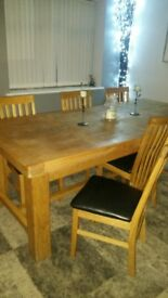 solid wood extendable dining table and 6 chairs for sale , good condition .