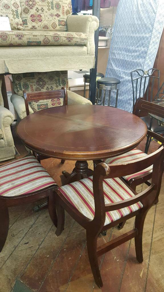 extending mahogany table and 4 chairs