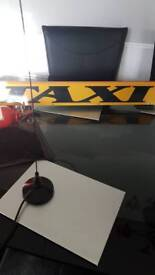 Taxi sign Aerial and fire extinguisher