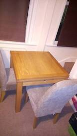 Dining table and 2 chairs...Can be delivered.....
