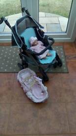 Doll, Silver Cross Buggy and carry basket.